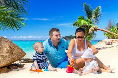 Family with twins on sun holidays