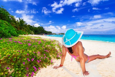 Photo for Woman in hat enjoying sun holidays on the tropical beach - Royalty Free Image