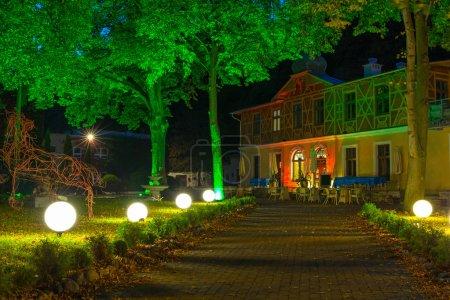 Colorful brick house at night