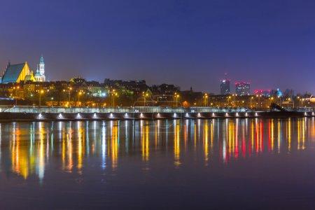 Panorama of Warsaw at night with reflection in Vistula river
