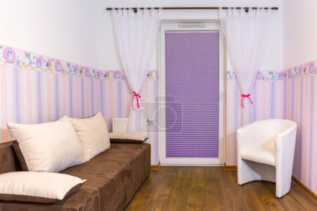 Bright baby room with wallpaper