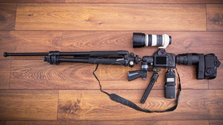 Camera equipment in the shape of machine gun