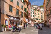People walking on the street of Riomaggiore village in Italy