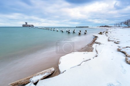 Photo for Frozen wooden breakwaters line to the world war II torpedo platform at Baltic Sea, Babie Doly, Poland - Royalty Free Image
