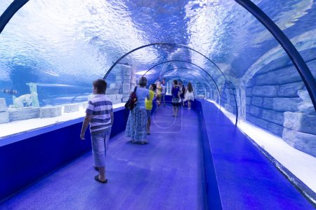 Antalya, Turkey-1 September 2014 People in the  aquarium. IT  is  longest of  world panoramic tunnel with alength  131 meters