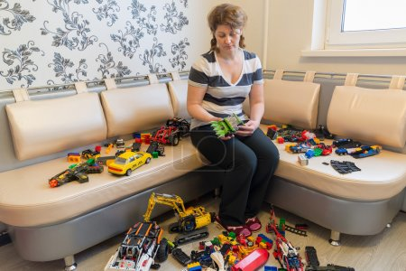 Mom and Children toys on  floor in the room