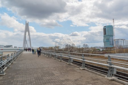 Krasnogorsk, RUSSIA - April 18,2015. Pedestrian bridge is built from two pylons, each measuring 41 m tall. Pylons are connected to spans with help of 28 straight cable wires, which hold up suspension