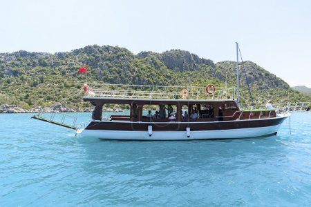 Kemer, Turkey - 06.20.2015. Boat with tourists near  coast of Turkey