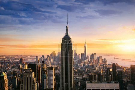 Photo for New York City skyline with urban skyscrapers at sunset, USA. - Royalty Free Image
