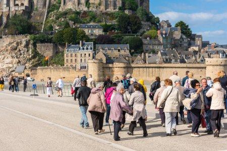 People visiting Mont Saint Michel monastery