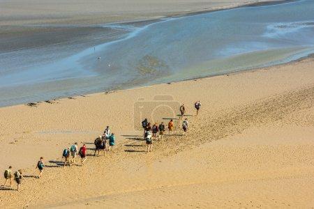 People on the beach near Mont Saint Michel