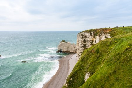 The beach and stone cliffs in Etretat