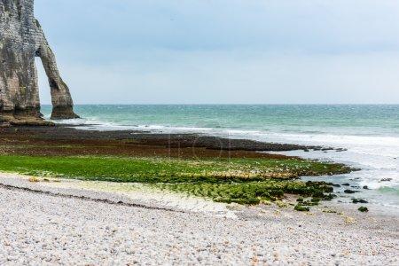 The beach and stone cliffs