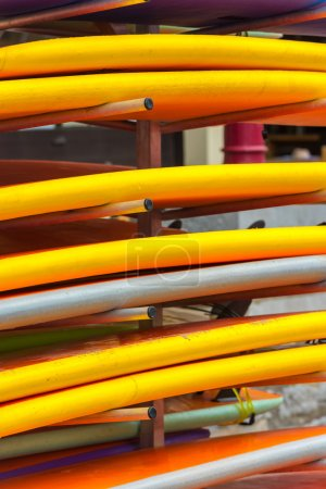 Surf boards in a stack