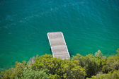 Small wooden pier on water