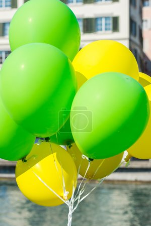 Bright yellow and green balloons