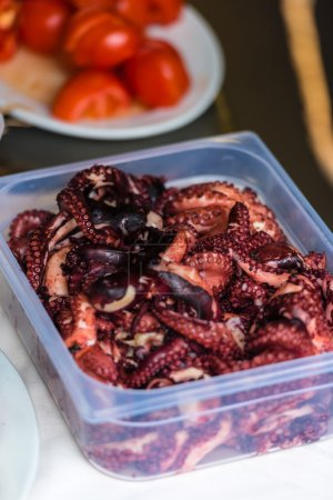 Cooked octopus parts in a box
