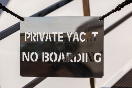 Photo for Bridge of a private luxury ship with a no entry private yacht sign. no boarding - Royalty Free Image