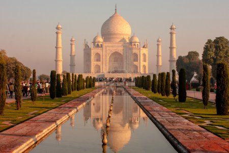Photo for Tourists visit Taj Mahal. Taj Mahal is India's most famous monument and is one of the most well known symbols of love - Royalty Free Image