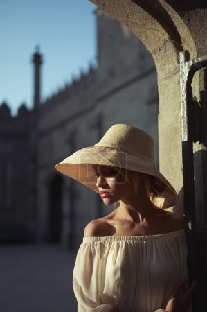 Photo for Beautiful young lady in straw hat in the palace - Royalty Free Image