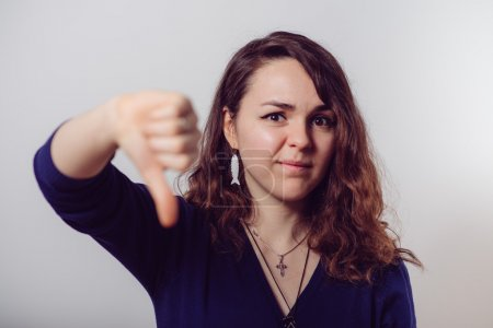 Woman showing a thumb down gesture
