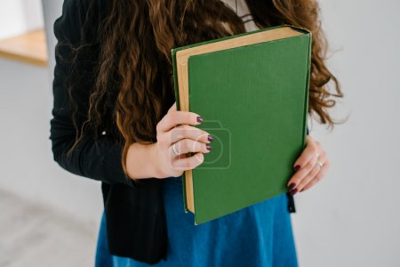 large book in hands