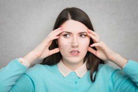 Woman suffering of of  headache