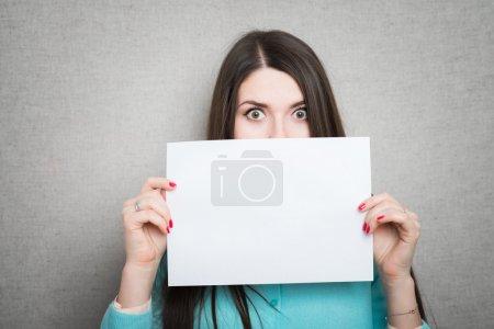 girl holding white blank paper