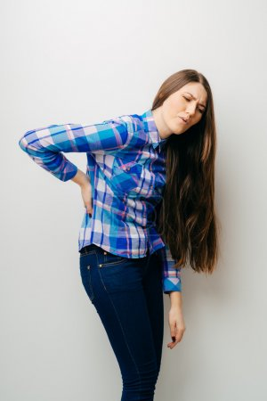 girl suffering from  back pain