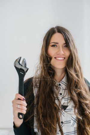 girl holding a wrench