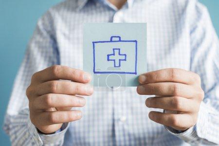 medicine chest icon on paper