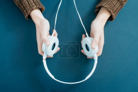 headphones in hands close up
