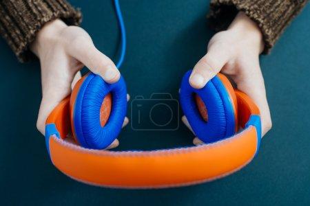 man holding headphones