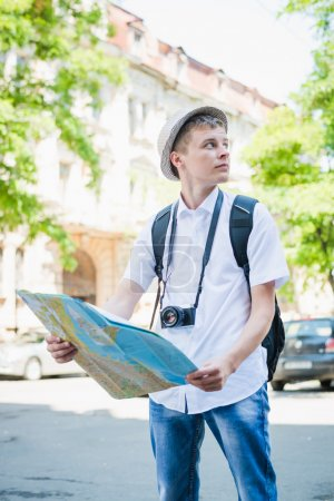 tourist standing with map