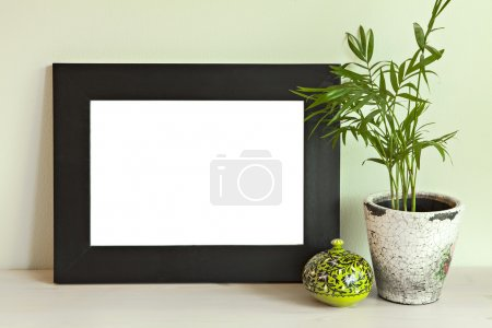 Photo for Image of a wooden frame mockup scene, on green wall. - Royalty Free Image