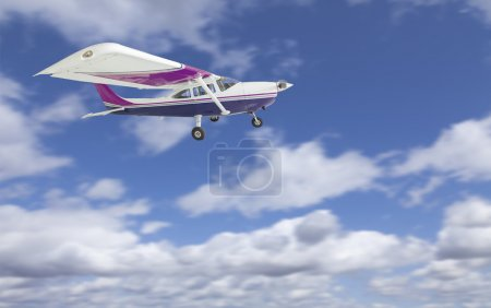 The Cessna 172 Single Propeller Airplane Flying In Sky