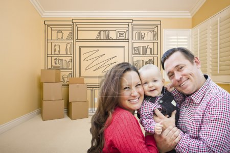 Photo for Young Family In Room With Moving Boxes and Drawing of Entertainment Unit On Wall. - Royalty Free Image