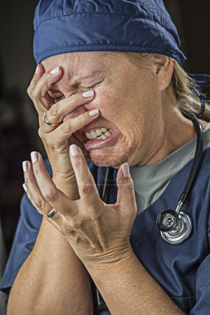 Photo for Hysterical Agonizing Crying Female Doctor or Nurse. - Royalty Free Image