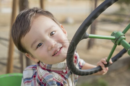 Mixed Race Young Boy Playing on Tractor