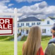 Curious Family Facing For Sale Real Estate Sign an...