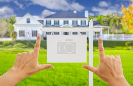Hands Framing Blank Real Estate Sign and New House