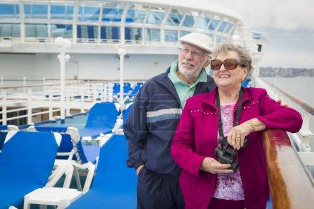 Senior Couple Enjoying The Deck of a Cruise Ship