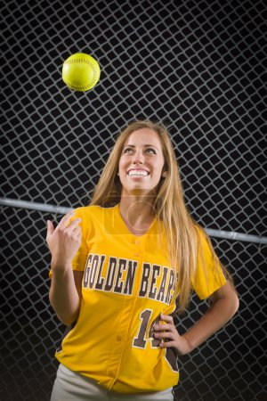 Photo for Young Female Softball Player Portrait with Ball in the Air. - Royalty Free Image