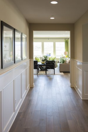 Home Entry Way with Wood Floors and Wainscoting