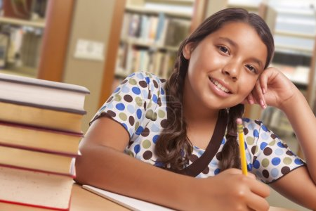 Hispanic Girl Student Studying in Library