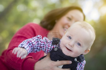Photo for Cute Little Baby Boy Having Fun With Mommy Outdoors. - Royalty Free Image