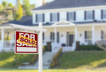 Photo for Sold Home For Sale Real Estate Sign in Front of Beautiful New House. - Royalty Free Image