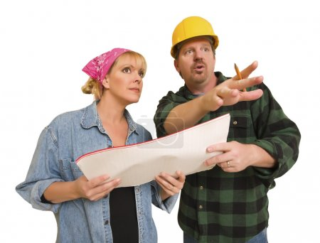 Contractor in Hard Hat Discussing Plans with Woman On White