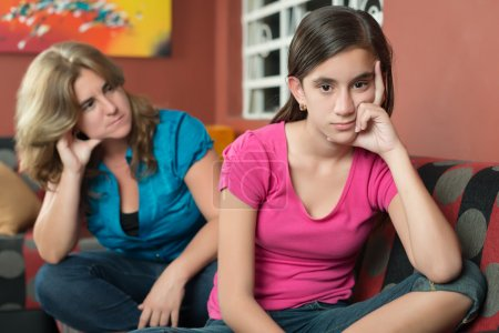 Photo for Teenage problems - Teenage girl with her sad and worried mother - Royalty Free Image