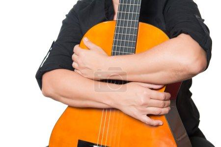 Arms hugging  guitar